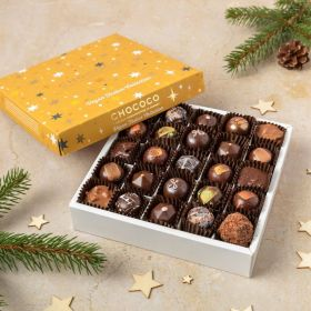 a box of 25 vegan handcrafted dark festive Christmas chocolates by Chococo with handing stars around the gold foiled starry box lid