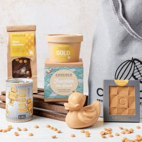 A gold chocolate hamper with robots, duck, mini bar and triple choc slab by Chococo