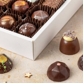 The small box of 9 handcrafted festive collection christmas chocolates by chococo