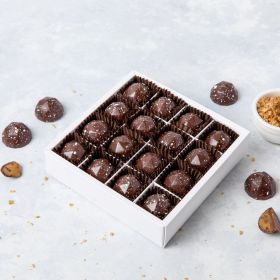 A close up of 16 Dorset Sea Salted Caramel chocolates in a box