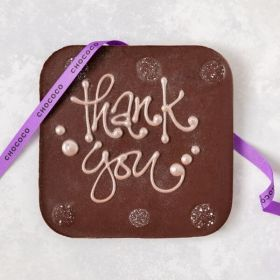A Chococo  dark chocolate giant bar with a hand piped Thank you written on. Proudly handcrafted in Dorset