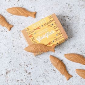 A box of fish shapes made from gold chocolate by Chococo proudly handcrafted in DOrset