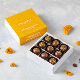 Honeycombe handcrafted milk chocolates by Chococo in chocolate box with scattered pieces around