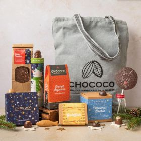 assorted chocolate Christmas canvas bag hamper by Chococo with handcrafted chocolates, fish, snowmen, lolly, bars, and slabs