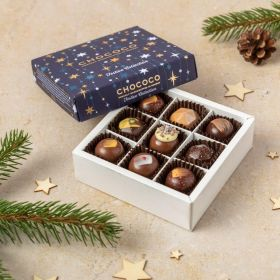 A festive giftbag hamper by chococo with an array of milk chocolate and gold chocolates