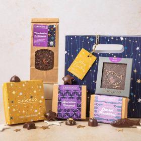 vegan festive giftbag hamper by Chococo with an array of handcrafted chocolates, dark chocolate selection of caramel stars, mackerel fish, robin bars and slabs