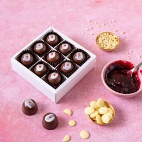 Cherry bakewellchocolates in a box of 9 by Chococo with almond nibs, white chocolate buttons and sour cherry jam