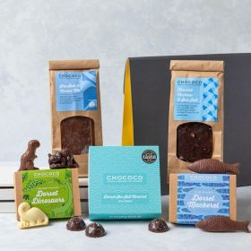 THe Dorset Chocolate Hamper by Chococo with novelty dino shapes and fish, milk and dark chocolate slabs ad a box of 9 Dorset sea salt chocolate