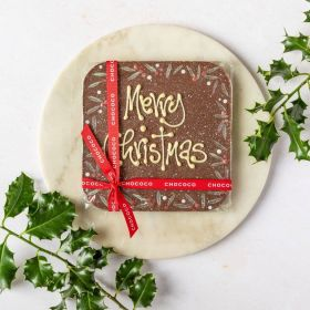 milk chocolate giantmessage bar with Merry Christmas hand piped on by Chococo