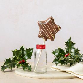 milk chocolate honeycomb star handcrafted in Dorset by Chococo sat in a milk jar with holly and linen napkin surround