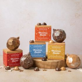 Gold chocolate bauble by Chococo  with 4 gem chocolates inside