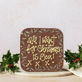 A giant milk chocolate message bar by Chococo which is hand piped with a personalised now saying 'all I want for Christmas is you!'