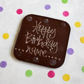 A Chococo giant dark chocolate bar write their name on surrounded by buttons. proudly handcrafted in Dorset