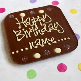A Chococo giant milk chocolate bar write their name on surrounded by buttons. proudly handcrafted in Dorset