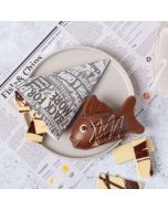 A novelty chocolate fish & chips made from milk & white chocolate by Chococo with newspaper place mat