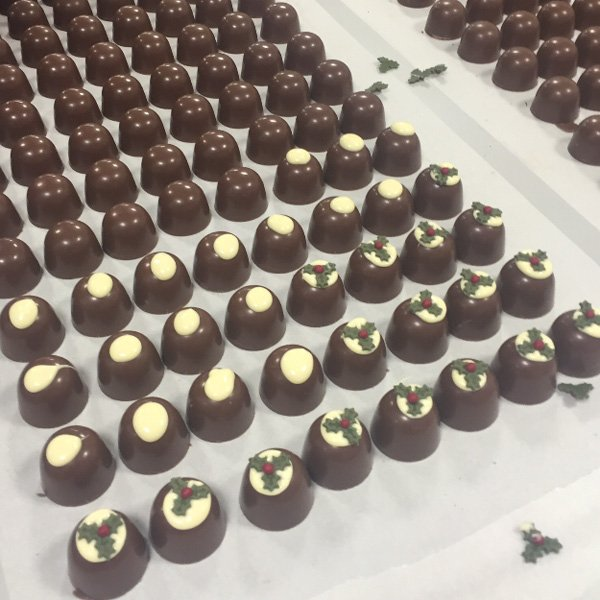 Chococo Fizzy Puddings being topped